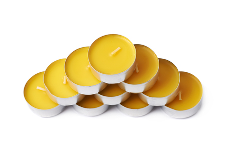 paraffin: Pyramid made of tealight paraffin wax yellow candles isolated over the white background