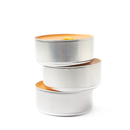 paraffin: Stack of tealight paraffin wax orange candles isolated over the white background