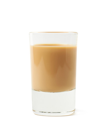 shot: Shot of cream liqueur isolated over the white background Stock Photo