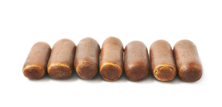 licorice: Chocolate coated licorice stick candy isolated over the white background Stock Photo