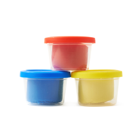 childs play clay: Pile of modeling clay container boxes isolated over the white background