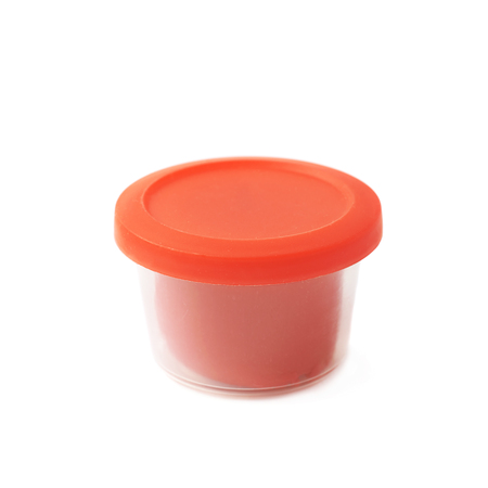 child's play clay: Red modeling clay in a plastic container isolated over the white background