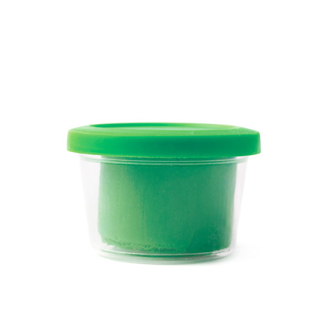 child's play clay: Green modeling clay in a plastic container isolated over the white background