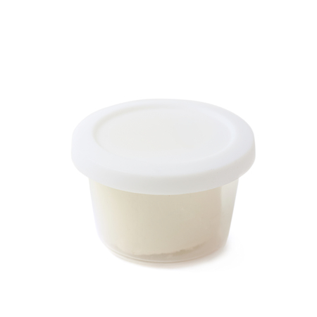 child's play clay: White modeling clay in a plastic container isolated over the white background Stock Photo
