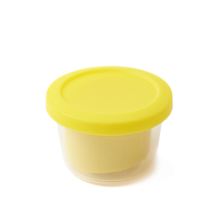 childs play clay: Yellow modeling clay in a plastic container isolated over the white background