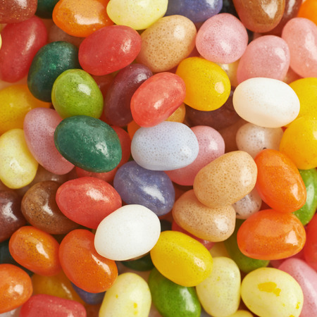 jellybean: Surface covered with multiple colorful jelly bean candies as a backdrop composition