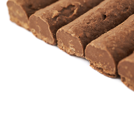 praline: Line of chocolate praline candies isolated over the white background, close-up background fragment