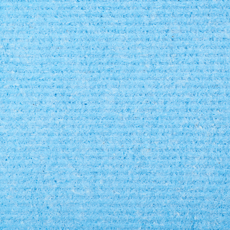 kitchen equipment: Blue kitchen wipe cloth close-up fragment as a background texture