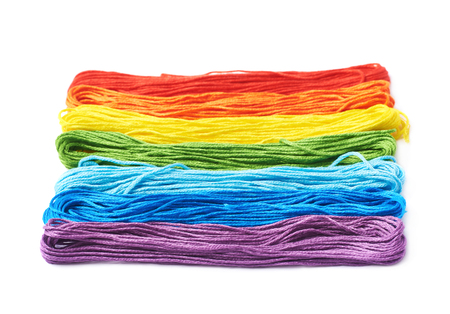 Rainbow colored embroidery thread yarn isolated over the white background