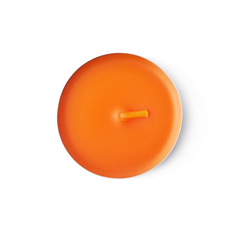 paraffin: Single tealight paraffin wax orange candle isolated over the white background, top view above