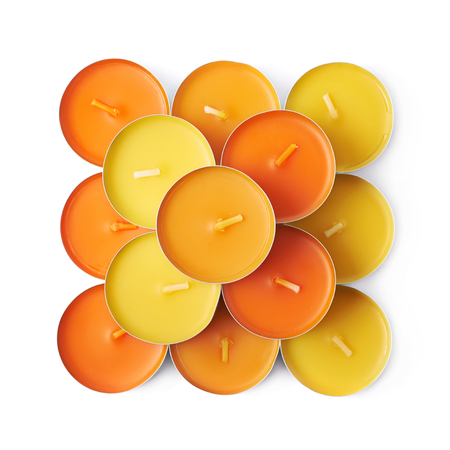 paraffin: Multiple tealight paraffin wax orange candles composition isolated over the white background