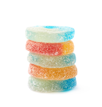 torus: Pile of torus shaped gelatin based sour sweet chewing candies isolated over the white background Stock Photo