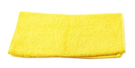 terry: Single yellow terry cloth towel isolated over the white background