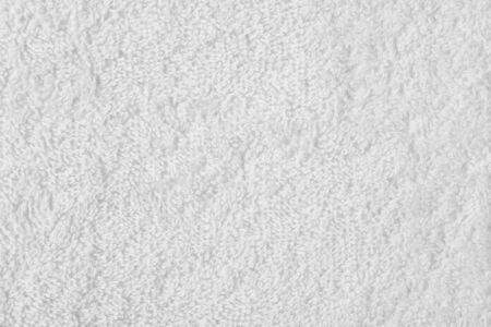 Terry cloth white towel fragment as a background texture