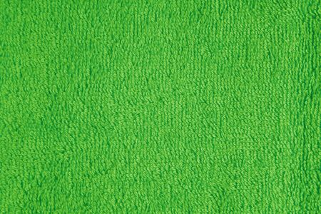 terry: Terry cloth green towel fragment as a background texture Stock Photo