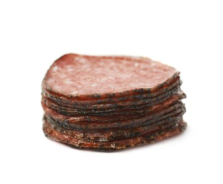 salame: Pile of multiple salami sausage slices isolated over the white background Stock Photo