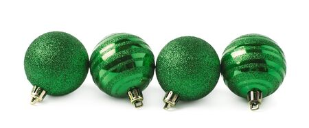 tree line: Multiple green Christmas tree decorational balls arranged in a line, composition isolated over the white background