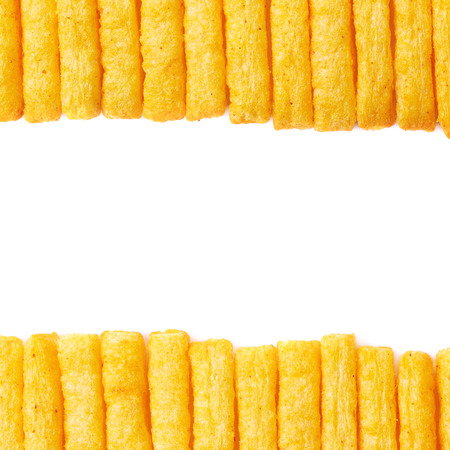 multiple images: Multiple cheese puff stick corn snacks arranged in a line as the images borders, composition isolated over the white background Stock Photo