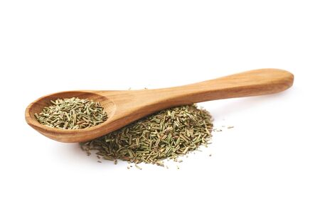 compostion: Pile of dried rosmarinus seasoning with a wooden spoon on top of it, compostion isolated over the white background Stock Photo