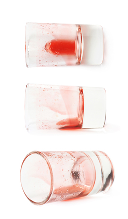 grenadine: Glass shot with grenadine red syrup leftovers isolated over the white background, set of three different foreshortenings