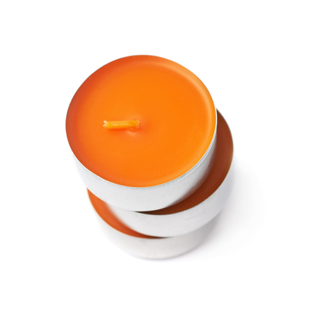 tealight: Stack of tealight paraffin wax orange candles isolated over the white background