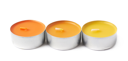 tealight: Three tealight paraffin wax orange candles isolated over the white background