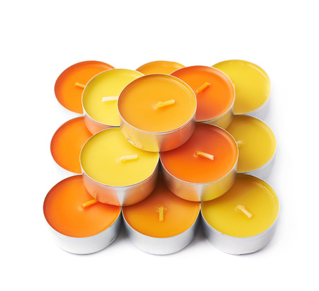 tealight: Multiple tealight paraffin wax orange candles composition isolated over the white background