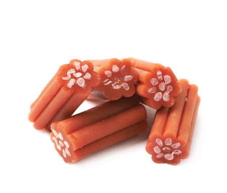 licorice: Red licorice stick chewing candy isolated over the white background