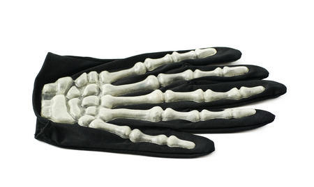 thumb x ray: Skeleton hand glove as a part of a Halloween costume, isolated over the white background