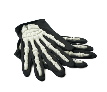 Pair of skeleton hand gloves as a part of a Halloween costume, isolated over the white background