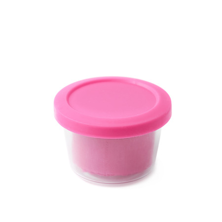 child's play clay: Pink modeling clay in a plastic container isolated over the white background Stock Photo