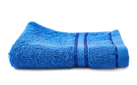 terry: Single blue terry cloth towel isolated over the white background