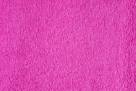 terry: Terry cloth pink purple towel fragment as a background texture