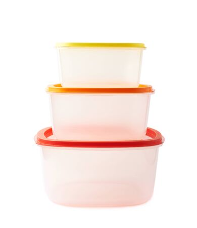 Pyramid pile of colorful plastic food containers, composition isolated over the white background