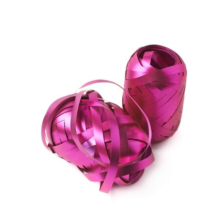 unwrapped: Glossy purple pink ribbon reel partly unwrapped, composition isolated over the white background