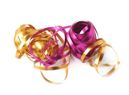 unwrapped: Pile of glossy ribbon reels partly unwrapped, composition isolated over the white background