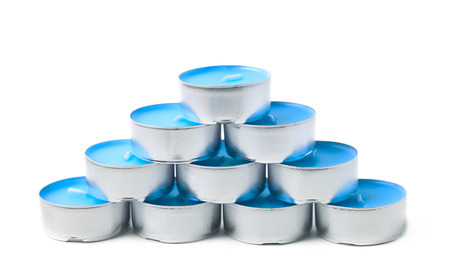 tealight: Pyramid of tealight paraffin wax blue candles isolated over the white background