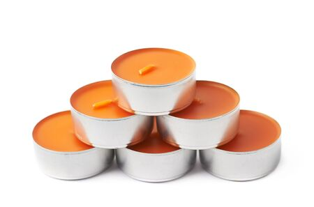 tealight: Pyramid of tealight paraffin wax orange candles isolated over the white background