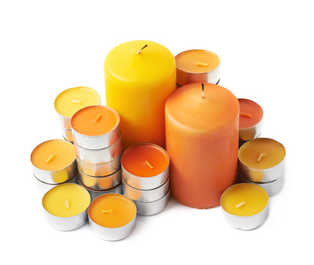 tealight: Multiple orange tealight and wax candle Halloween composition isolated over the white background