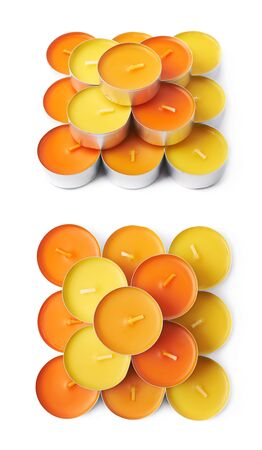 tealight: Multiple tealight paraffin wax orange candles composition isolated over the white background, set of two different foreshortenings Stock Photo