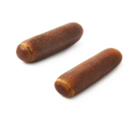 licorice: Chocolate coated licorice stick candy isolated over the white background, set of two different foreshortenings