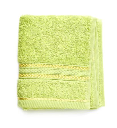 terry: Single green terry cloth towel isolated over the white background