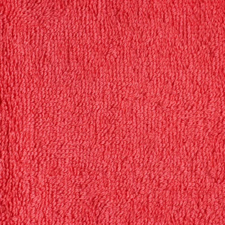terry: Terry red cloth towel fragment as a background texture Stock Photo