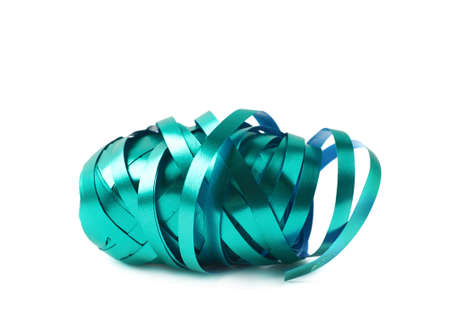 unwrapped: Glossy green ribbon reel partly unwrapped, composition isolated over the white background