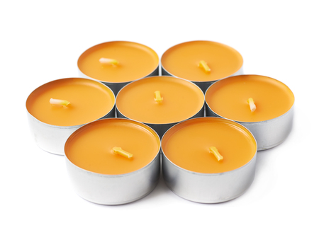 tealight: Pile of tealight paraffin wax orange candles isolated over the white background