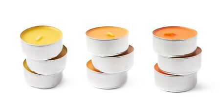tealight: Stack of tealight paraffin wax orange candles isolated over the white background, set of three different foreshortenings