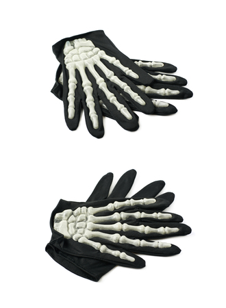 thumb x ray: Pair of skeleton hand gloves as a part of a Halloween costume, isolated over the white background, set of two different foreshortenings