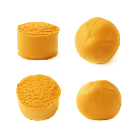 child's play clay: Piece of an orange modelling clay isolated over the white background, set of four different foreshortenings Stock Photo