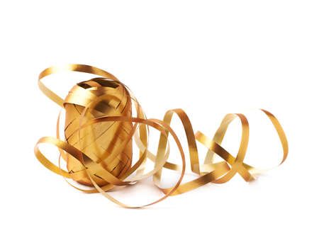 unwrapped: Glossy golden ribbon reel partly unwrapped, composition isolated over the white background