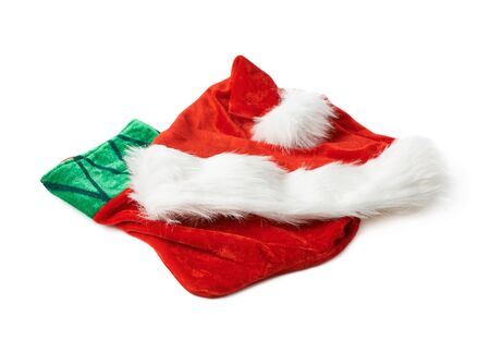 stocking cap: Santas red hat cap and Christmas sock shaped bag stocking, composition isolated over the white background Stock Photo